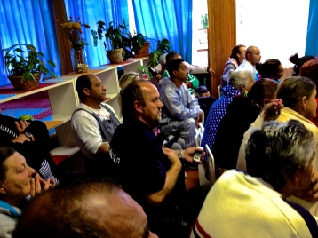 """A community meeting in the """"numbered streets"""" settlement, behind the soccer stadium. Residents are being evicted to make room for a parking lot."""